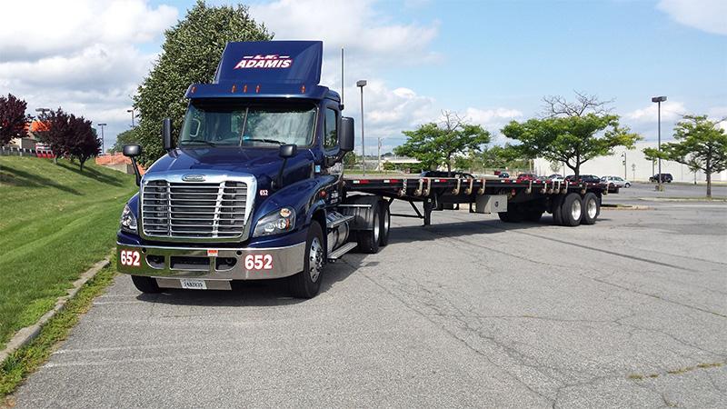 adamis_trucking_flatbed_equipment_transport.jpg
